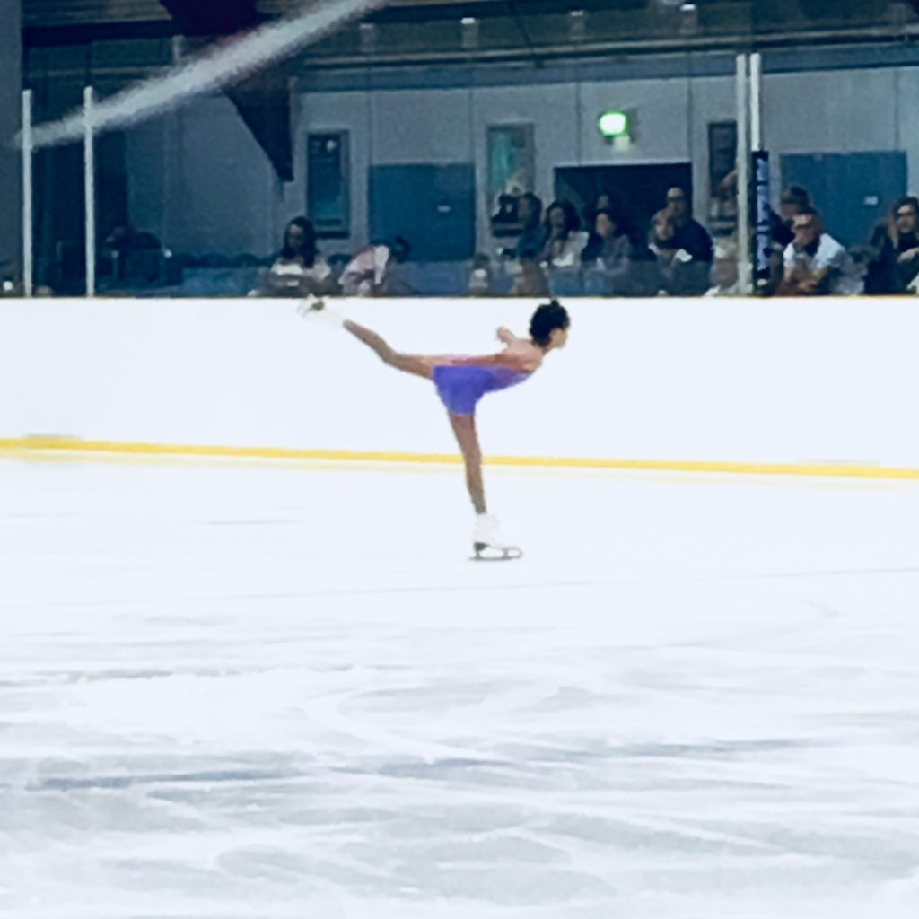 Young iceskater performs in an iceskating competition - iceskating.london
